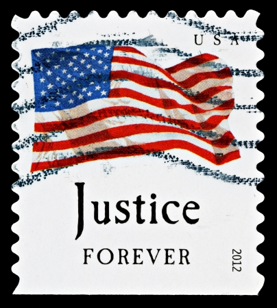 sates: UNITED STATES - CIRCA 2012: A Used USA Postage Stamp showing the United Sates Flag and Justice Forever, circa 2012