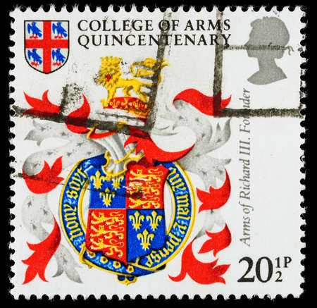 franked: UNITED KINGDOM - CIRCA 1984: A used postage stamp printed in Britain celebrating the 500th Anniversary of the College of Arms showing the Arms of King Richard the Third