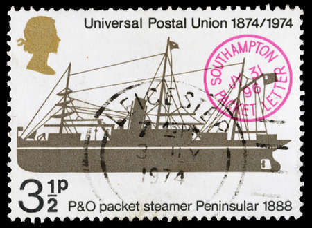 franked: UNITED KINGDOM - CIRCA 1974: A used postage stamp printed in Britain celebrating the Centenary of the Universal Postal Union showing the P&O Packet Steamer Peninsular