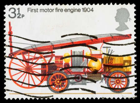 elizabeth: UNITED KINGDOM - CIRCA 1974: A used postage stamp printed in Britain celebrating the Bicentenary of the Fire Prevention Act showing the First Motor Fire Engine