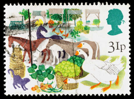 fairs: UNITED KINGDOM - CIRCA 1983: A used postage stamp printed in Britain celebrating British Fairs shwoing Early Produce Fair Editorial