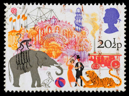 fairs: UNITED KINGDOM - CIRCA 1983: A used postage stamp printed in Britain celebrating British Fairs showing Circus and Amusement Rides