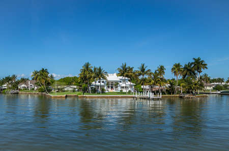 waterside: NAPLES, FLORIDA USA - May 8 2013: Luxury waterside home in the bayside area of Naples. Naples is one of the wealthiest cities in the United States