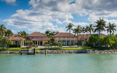 NAPLES, FLORIDA USA - May 8 2013: Large waterfront residence in the bayside area of Naples. Naples is one of the wealthiest cities in the United States Redakční