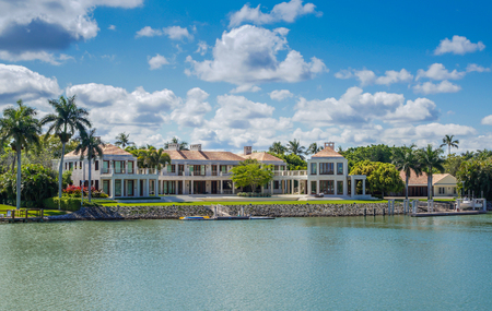 waterside: NAPLES, FLORIDA USA - May 8 2013: Large luxury waterfront mansion in the bayside area of Naples. Naples is one of the wealthiest cities in the United States
