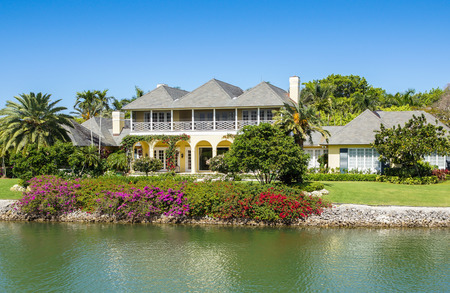 NAPLES, FLORIDA USA - May 8 2013: Waterfront  house with colourful gardens on the bayside area of Naples. Naples is one of the wealthiest cities in the United States Editorial