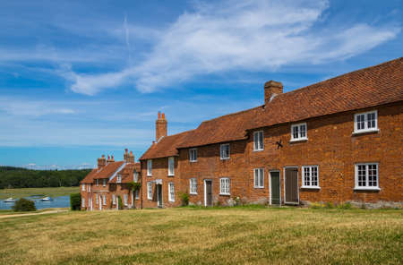 hampshire: BUCKLERS HARD, UNITED KINGDOM - 17 JULY 2014: Historic Cottages in the Maritime Ship Building Village of Bucklers Hard in Hampshire