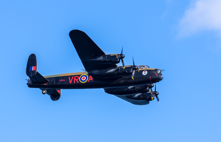devon: DAWLISH, UNITED KINGDOM - AUGUST 23 2014: Canadian Lancaster Bomber CG-VRA flying at the Dawlish Airshow. CG-VRA is one of the Two Remaining Flying Lancaster Bombers Editorial