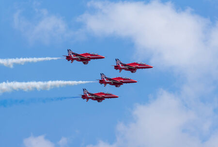 DAWLISH, UNITED KINGDOM - AUGUST 23 2014: The Royal Air Force Red Arrows aerobatics display team flying at the Dawlish Airshow Redakční