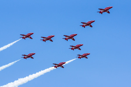 royal air force: DAWLISH, UNITED KINGDOM - AUGUST 23 2014: The Royal Air Force Red Arrows aerobatics display team flying at the Dawlish Airshow Editorial