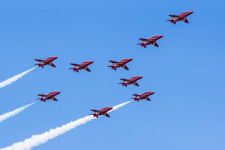 air show: DAWLISH, UNITED KINGDOM - AUGUST 23 2014: The Royal Air Force Red Arrows aerobatics display team flying at the Dawlish Airshow Editorial