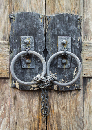 chained: Closeup of Chained and Locked Wooden Door