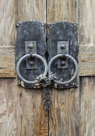 padlocked: Closeup of Chained and Locked Wooden Door
