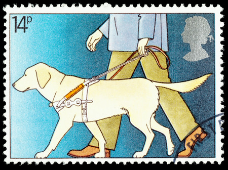 commemorating: UNITED KINGDOM - CIRCA 1981: A British Used Postage Stamp Commemorating The Year of the Disabled Showing Blind Man with Guide Dog