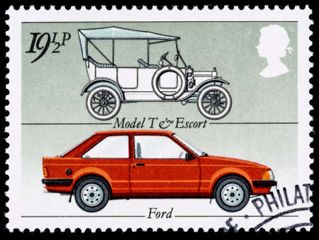stamp: UNITED KINGDOM - CIRCA 1982: A British Used Postage Stamp celebrating the British Motor Industry, showing a Ford Model T and Ford Escort Car Editorial