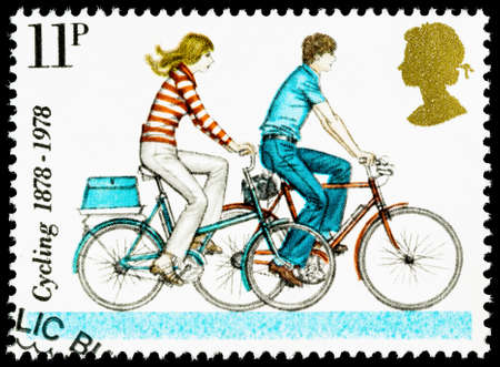used stamp: UNITED KINGDOM - CIRCA 1978: A British Used Postage Stamp celebrating cycling, showing Modern Small Wheeled Bicycles