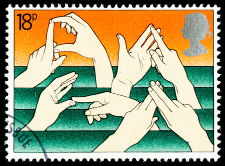 commemorating: UNITED KINGDOM - CIRCA 1981: A British Used Postage Stamp Commemorating The Year of the Disabled Showing Sign Language
