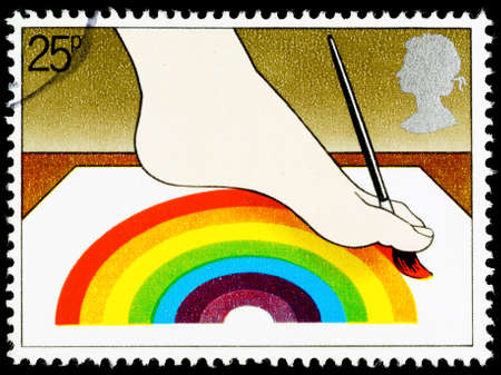 commemorating: UNITED KINGDOM - CIRCA 1981: A British Used Postage Stamp Commemorating The Year of the Disabled Showing Disabled Artist Painting with Foot