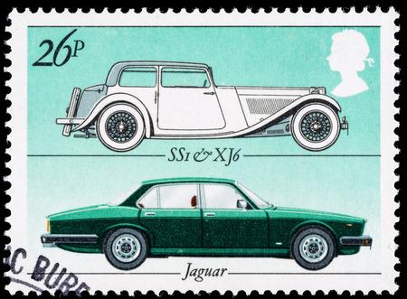 motor cars: UNITED KINGDOM - CIRCA 1982: A British Used Postage Stamp celebrating the British Motor Industry, showing Jaguar SSI and Jaguar XJ6 Cars Editorial