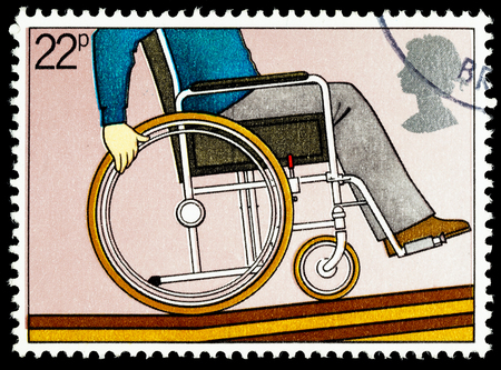 UNITED KINGDOM - CIRCA 1981: A British Used Postage Stamp Commemorating The Year of the Disabled Showing Disabled Person in a Wheelchair