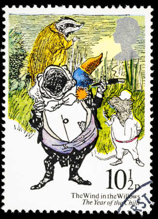willows: UNITED KINGDOM - CIRCA 1979: A used postage stamp printed in Britain showing The Wind in the Willows