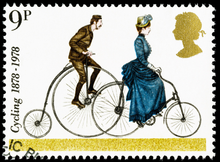 postage: UNITED KINGDOM - CIRCA 1978: A British Used Postage Stamp celebrating cycling, showing a Penny Farthing and 1884 Safety Bicycle Editorial