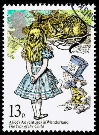 cheshire cat: UNITED KINGDOM - CIRCA 1979: A used postage stamp printed in Britain showing Alice in Wonderland