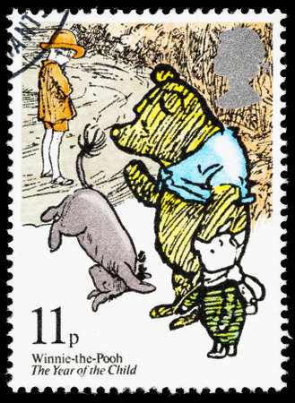 postage stamp: UNITED KINGDOM - CIRCA 1979: A used postage stamp printed in Britain showing Winnie the Pooh, Eyeore and Piglet Editorial