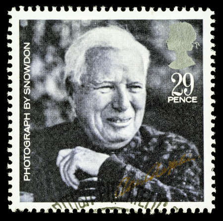 chaplin: UNITED KINGDOM - CIRCA 1985: A used postage stamp printed in Britain celebrating British Film Year showing Charlie Chaplin Editorial
