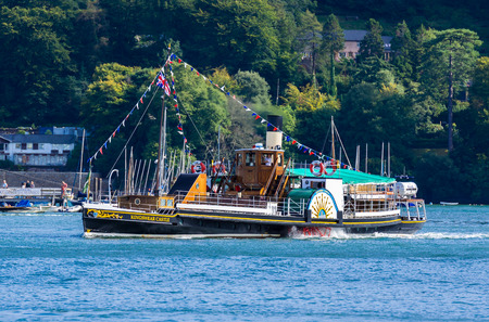 devon: DARTMOUTH, UNITED KINGDOM - AUGUST 28, 2015: KIngswear Castle Paddle Steamer. The Kingswear Castle runs Visitor Pleasure Cruises on the River Dart at Kingswear and Dartmouth, Devon