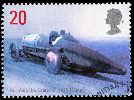 postage stamp: UNITED KINGDOM - CIRCA 1998: Used postage stamp printed in Britain celebrating British Land Speed Records showing Sir Malcolm Campbell 1925 Bluebird Car