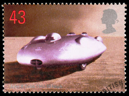 postage stamp: UNITED KINGDOM - CIRCA 1998: Used postage stamp printed in Britain celebrating British Land Speed Records showing John Cobb 1947 Railton Mobil Special Car