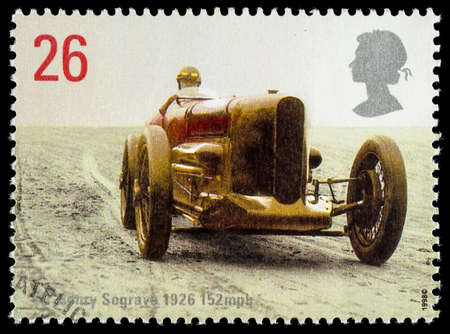 postage stamp: UNITED KINGDOM - CIRCA 1998: Used postage stamp printed in Britain celebrating British Land Speed Record Holders showing Sir Henry Seagrave 1926 Record Sunbeam Car Editorial