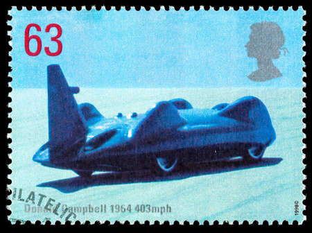 donald: UNITED KINGDOM - CIRCA 1998: Used postage stamp printed in Britain celebrating British Land Speed Records showing Donald Campbell 1964 Bluebird Car