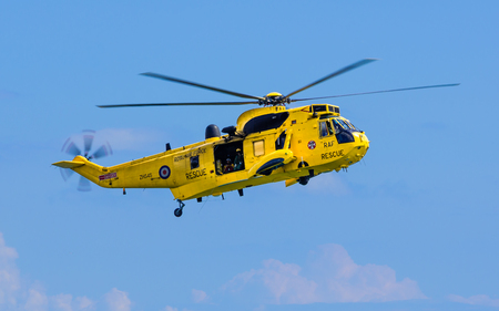 rescue helicopter: DAWLISH, UNITED KINGDOM - AUGUST 23, 2014: Royal Navy Sea King Search and Rescue Helicopter Flying at the Dawlish Airshow