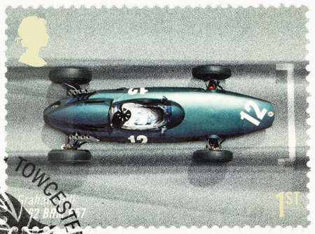postage stamp: UNITED KINGDOM - CIRCA 2007: A used postage stamp printed in Britain celebrating the 50th Anniversary of the British Grand Prix showing Granham Hill in a 1962 BRM P57