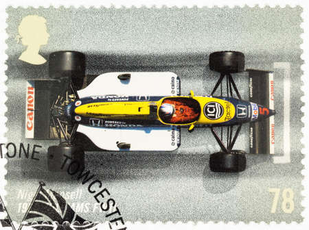 postage stamp: UNITED KINGDOM - CIRCA 2007: A used postage stamp printed in Britain celebrating the 50th Anniversary of the British Grand Prix showing Nigel Mansell in a 1986 Williams