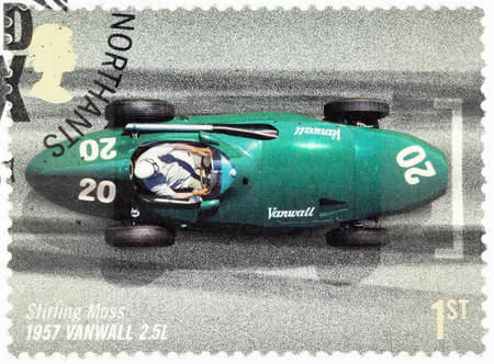 postage stamp: UNITED KINGDOM - CIRCA 2007: A used postage stamp printed in Britain celebrating the 50th Anniversary of the British Grand Prix showing Stirling Moss in a 1957 Vanwall Editorial