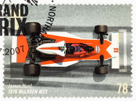 postage stamp: UNITED KINGDOM - CIRCA 2007: A used postage stamp printed in Britain celebrating the 50th Anniversary of the British Grand Prix showing James Hunt in a 1976 Mclaren M23