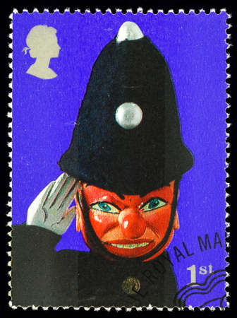 used stamp: UNITED KINGDOM - CIRCA 2001: A used postage stamp printed in Britain celebrating Punch and Judy Show Puppets showing Policeman Puppet