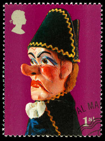 used stamp: UNITED KINGDOM - CIRCA 2001: A used postage stamp printed in Britain celebrating Punch and Judy Show Puppets showing Beadle Puppet Editorial