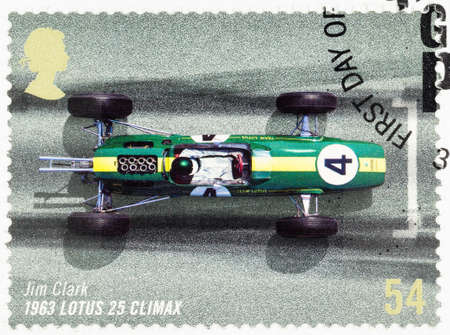 postage stamp: UNITED KINGDOM - CIRCA 2007: A used postage stamp printed in Britain celebrating the 50th Anniversary of the British Grand Prix showing Jim Clark in a 1963 Lotus 25 Climax Editorial