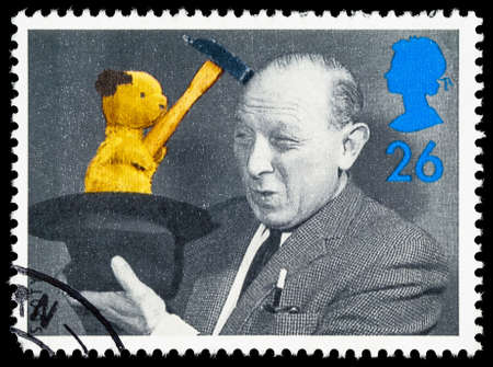 sooty: UNITED KINGDOM - CIRCA 1996: A used postage stamp printed in Britain celebrating the 5oth Anniversary of Childrens Television showing Sooty and Harry Corbett Editorial