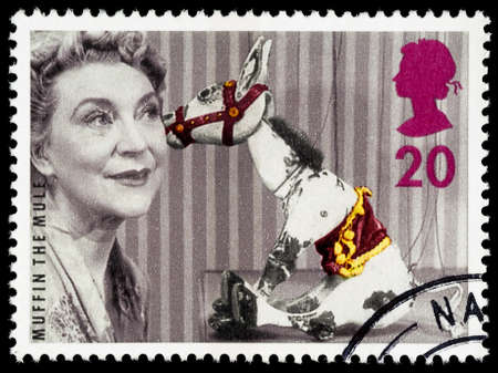 used stamp: UNITED KINGDOM - CIRCA 1996: A used postage stamp printed in Britain celebrating the 5oth Anniversary of Childrens Television showing Muffin the Mule