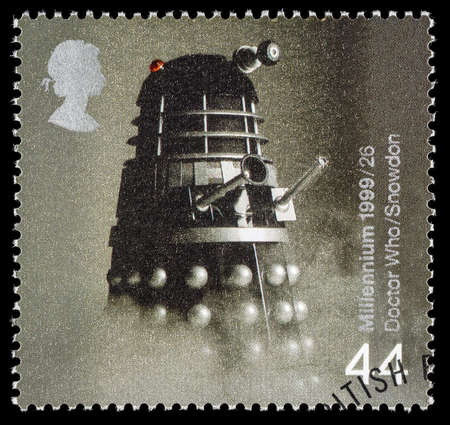 entertainers: UNITED KINGDOM - CIRCA 1999: A used postage stamp printed in Britain celebrating Entertainers showing a Dalek from Dr Who Editorial