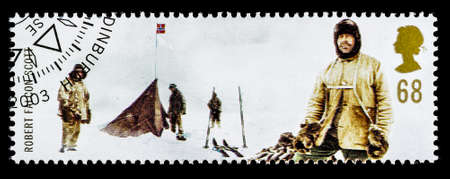scott: UNITED KINGDOM - CIRCA 2003: A used postage stamp printed in Britain celebrating British Explorers showing Robert Falcon Scott and the Norweigan Expedition at the South Pole