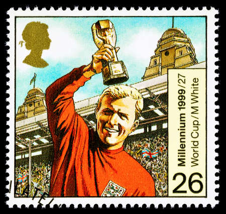 franked: UNITED KINGDOM - CIRCA 1999: A used postage stamp printed in Britain celebrating Entertainers showing the Famous Footballer Bobby Moore