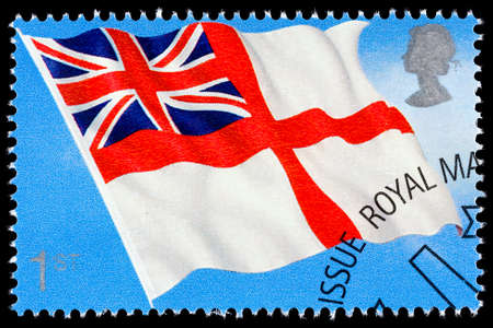 franked: UNITED KINGDOM - CIRCA 2001: A used postage stamp printed in Britain celebrating Flags and Ensigns showing the White Ensign Flag Editorial