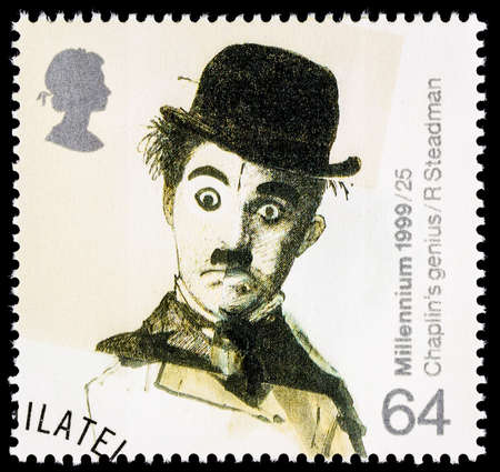 cinema film: UNITED KINGDOM - CIRCA 1999: A used postage stamp printed in Britain celebrating Entertainers showing the Famous Film Star Charlie Chaplin