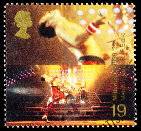 postage stamp: UNITED KINGDOM - CIRCA 1999: A used postage stamp printed in Britain celebrating Entertainers showing Freddie Mercury the Lead Singer of the Pop Music Band Queen Editorial